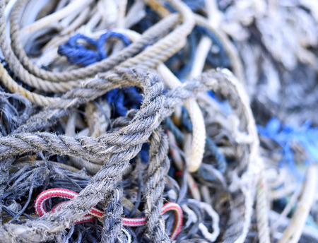 Weathered, old nautical ropes. Stack of ropes, close-up of nautical vessel. Stock Photo