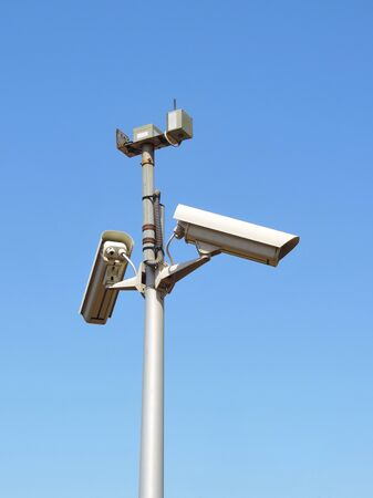 big brother spy: Security cameras and blue sky, security system. Stock Photo