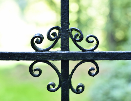 Wrought iron fence. decortaive fence, ornate boundary background. Stock Photo