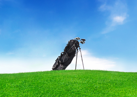 golf bag: Golf bag on a green meadow with clear blue sky and copyspace.