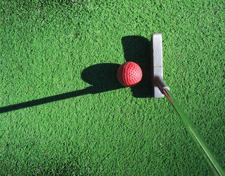 Mini golf, putting scene.