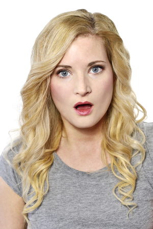 gape: Amazed blond woman looking to the camera. Surprised young woman, isolated on white background.