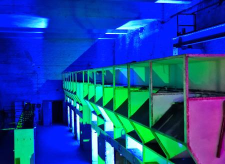 Iluminated industy hall or factory interior. Stock Photo