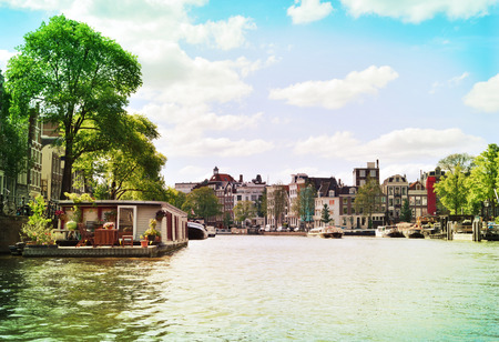 Amsterdam city scene with from Amstel river. Stock Photo