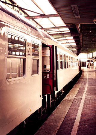 old train: Railway station with old train, toned image. Stock Photo