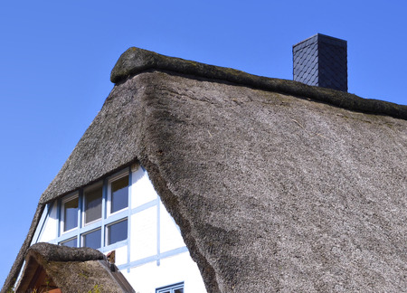 Thatched roof house, close-up shot. Stock Photo