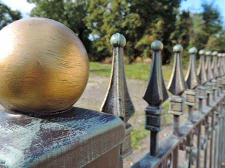 iron fence: Wrought iron fence of a luxury home. Stock Photo
