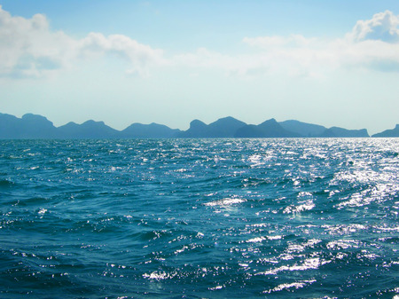 sparkling water: Sea scene with sparkling water and mountain range.