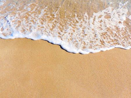 Close-up de sable et le surf sur la plage. plage ou sable texture. Sand background avec copie espace.
