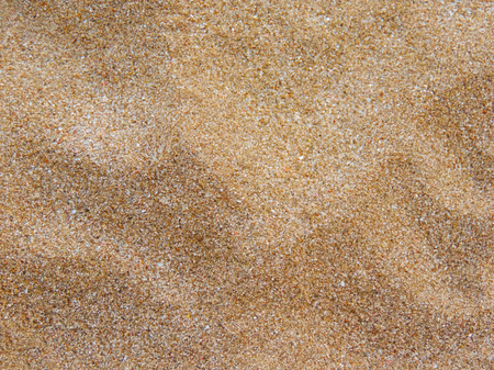 Close-up of sand on the beach. beach or sand texture. Sand background with copy space. Stock Photo