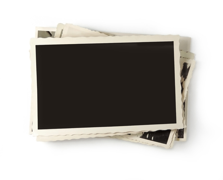 Stack of old, vintage photos with copy space, isolated on white background. Stock Photo