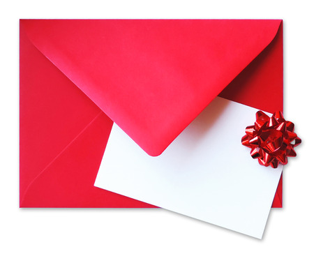 Red envelope with greeting card and red bow, isolated on white background.