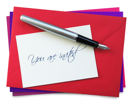 red envelope: Red envelope on a stack with invitation card, isolated on white background.