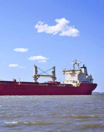 freight transportation: Freight ship, freight transportation scene Onto a river.