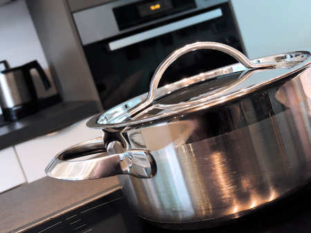stove top: Cooking pot on a glass ceramic stove top. Stock Photo