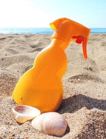 sun screen: Sun screen lotion or suntan on the beach. Stock Photo