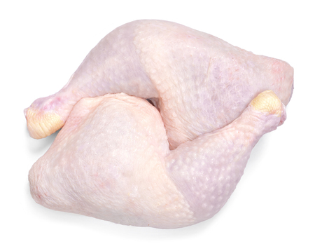 Fresh raw chicken meat, isolated on white background. Chicken drumsticks or legs, top view.