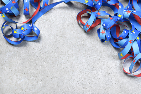 Birthday or holiday background with multicolored ribbon on a white background. Celebration background with curly ribbon and copy space.