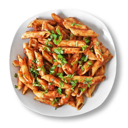 Delicious pasta dish with fresh basil on white background. Top view scene, healthy eating or healthy lifestyle. Penne napoli or pasta arrabiata, isolated. Standard-Bild