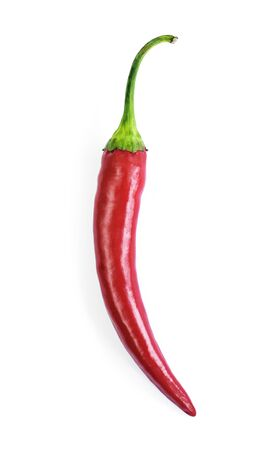 Red chilli pepper, cut out and isolated on white background. Hot spice, red chili pepper. Top view or high angle shot. Standard-Bild