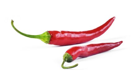 Red chilli peppers, cut out and isolated on white background. Hot spice, red chilli peppers. Top view or high angle shot.