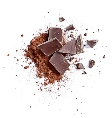 Cocoa powder and pieces of dark chocolate, isolated on white background. Cake ingredients, top view or high angle shot. Standard-Bild