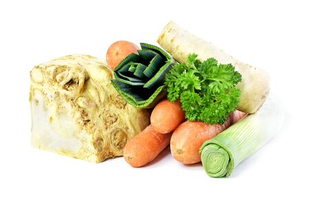 Soup vegetables, isolated on white background. Broth ingredients, celery, parsley, leek and carrots. Standard-Bild