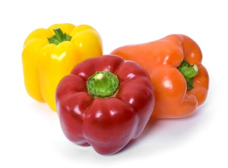 Fresh bell peppers isolated on white background. Red, orange and yellow bell peppers, cooking ingredients, healthy lifestyle. Standard-Bild