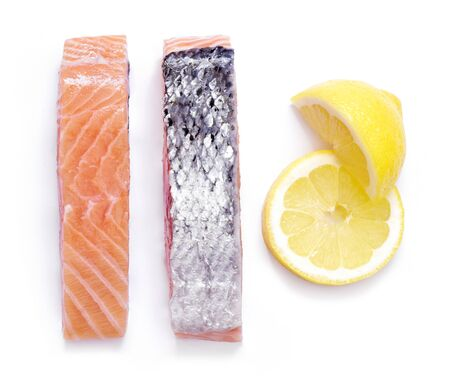 Raw salmon fillets, isolated on white background. Fresh fish, sushi quality salmon. Top view or high angle shot. Standard-Bild
