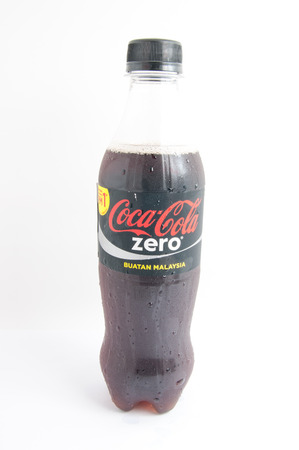 carbonated drink: Coca Cola Zero bottle on white background. Coca cola drink is the popular carbonated soft drink in the world are produced by The Coca Cola Company. - stock photo