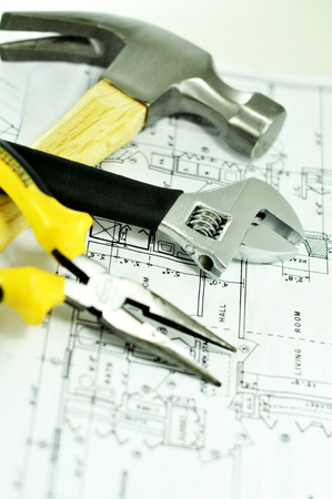 handtools: Hammer Wrench and Pliers on a Plan