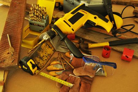handtools: Power tools on workshop table Stock Photo
