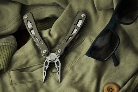 handtool: pocket tool on jacket with shades