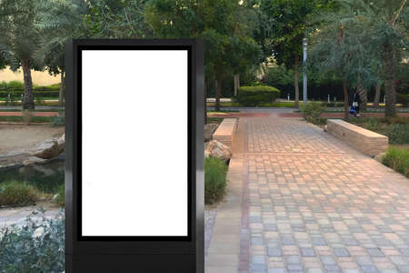 Outdoor light box advertisement space beside a pathway ideal for poster mock up, digital signage, video marketing display