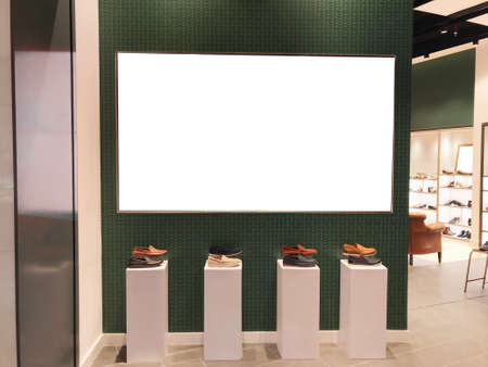 Large landscape light box digital signage in front of shoe retail store