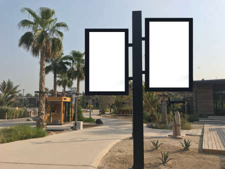 Outdoor light boxes at a park with trees and pavement ideal for sale discount promotion mock up