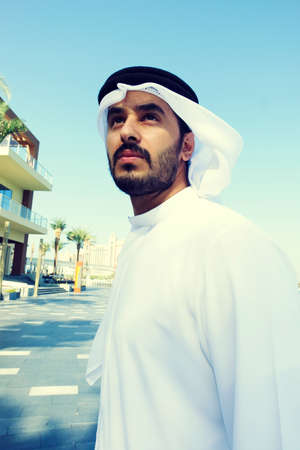 Close up portrait of Arabic Middle East man standing wearing traditional menswear 스톡 콘텐츠