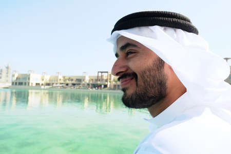 Happy Middle East Arab man smiling during daytime at an outdoor location 스톡 콘텐츠