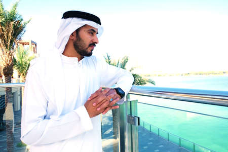 Rich Arab male  looking far with optimism about the future
