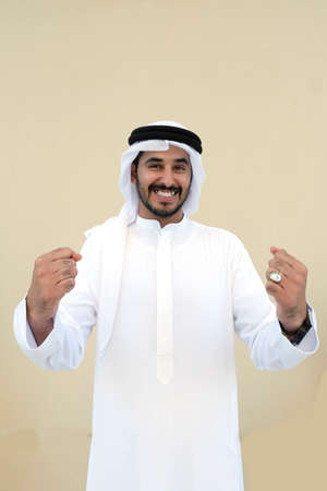 Arabic guy very happy and excited because of winning team 스톡 콘텐츠