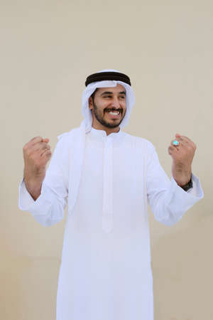 Arab guy very happy and excited because of winning team