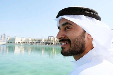 Close up shot of Arab man wearing traditional kandura menswear 스톡 콘텐츠