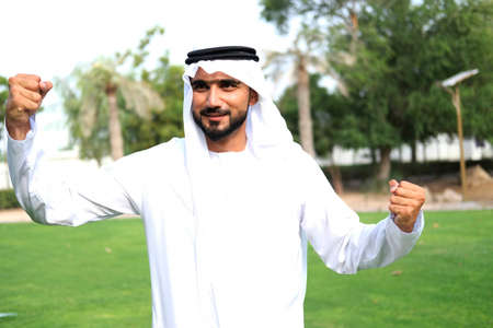 Local Arab man winning gesture ideal for winning or deal closed mock up