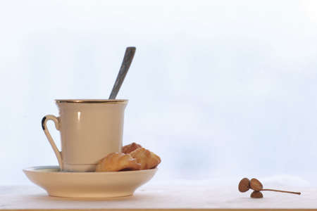 Morning coffee cup with cookie and acorn cap Stock Photo