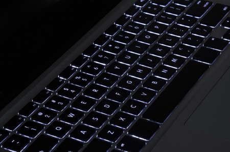 backlit keyboard: Illuminated backlit keyboard of an Apple Macbook Pro