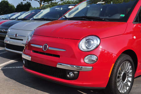 car dealers: Brand new Fiat 500 series in a car dealership Stock Photo