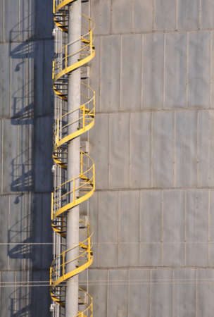 Yellow staircase spiraling to the top of a natural gas holding facility Stock Photo - 15217142