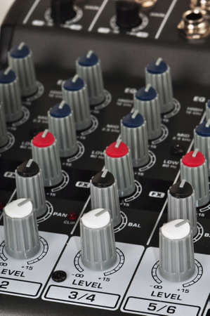 Detail of levels knobs on a modern music mixing console Stock Photo