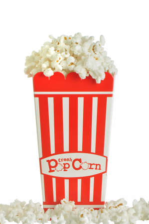 Popcorn container overflowing with tasty popcorn against a white background