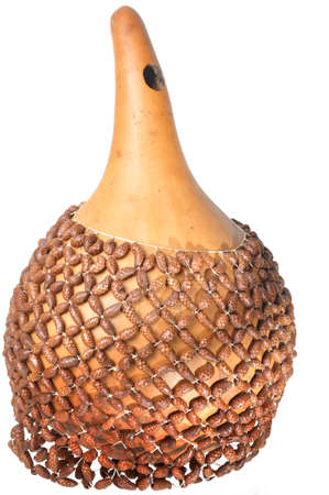 shekere: Isolated Shekere, an African rhythm instrument made from beads strung around a gourd which produces a rattling sound Stock Photo